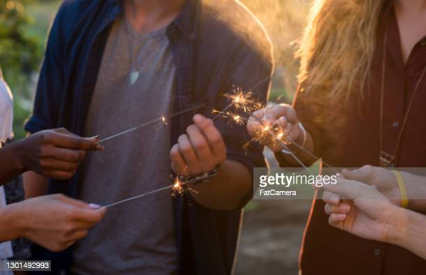 a party is only fun with sparklers - canada day stock pictures, royalty-free photos & images