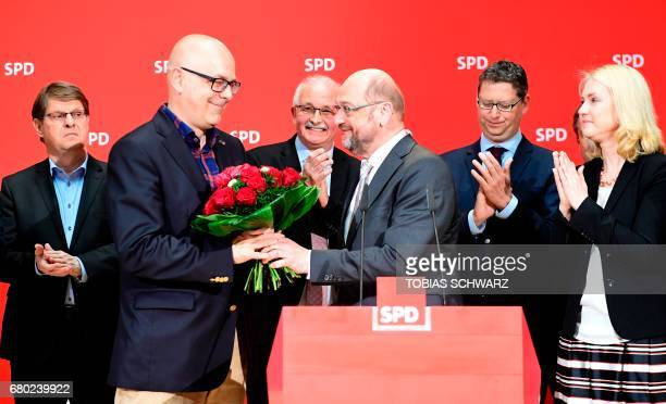 Party leader and Chancellor candidate of Germany's social democratic party SPD Martin Schulz hands flowers to SPD's topcandidate in SchleswigHolstein...