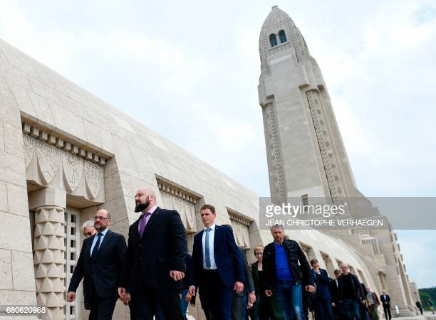 Party leader and Chancellor candidate of Germany's social democratic party SPD Martin Schulz and Olivier Gerard director of the Ossuary walk past the...