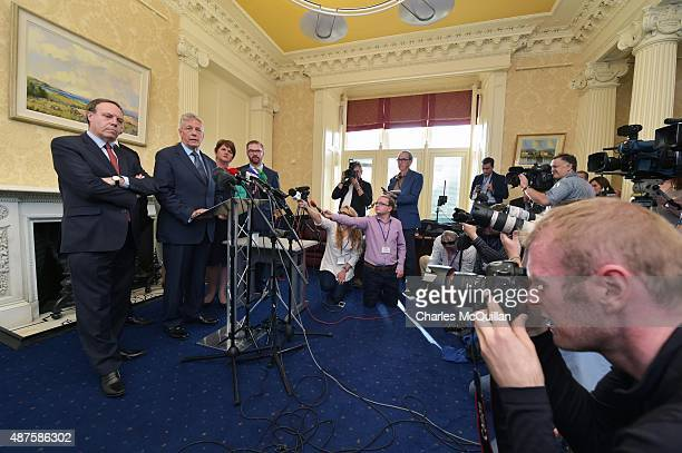 Party leader and Northern Ireland First Minister Peter Robinson reacts to questions as he held a press conference at Stormont on September 10, 2015...