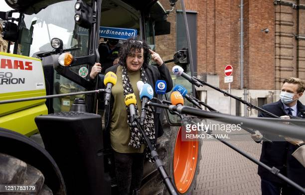 Party leader Caroline van der Plas of the BoerBurgerBeweging answers journalists' questions as he arrives in a tractor at the Binnenhof, the venue of...