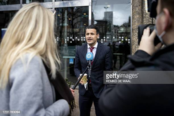 Party leader Farid Azarkan of DENK answers journalists' questions as he arrives at the Binnenhof, the venue of Netherlands' parliament, in The Hague,...