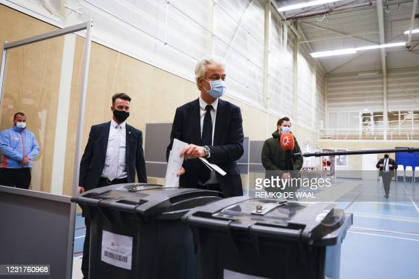 Party leader Geert Wilders casts his vote in the 2021 Dutch general elections in the Hague on March 17, 2021. - Polling stations opened on the last...