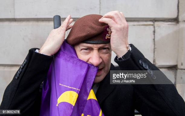 UKIP party leader Henry Bolton adjust his beret from the The Royal Hussars of which he was Lance Corporal during a Justice for Veterans protest at...