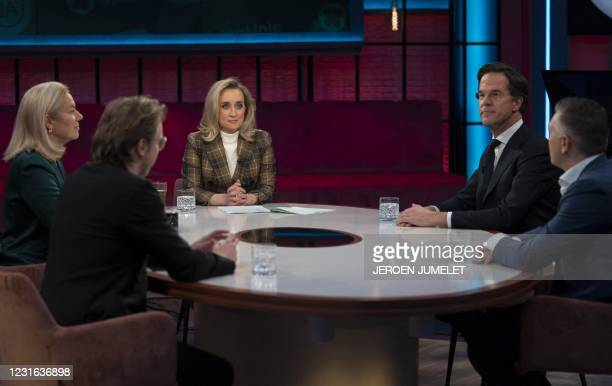 Party leader Mark Rutte , D66 party leader Sigrid Kaag and presenter Eva Jinek are seen during a broadcast debate on March 10, 2021 in Amsterdam. -...
