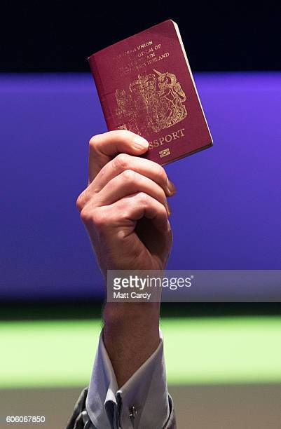 UKIP party leader Nigel Farage holds a passport aloft as he makes his farewell leaders speech at the Bournemouth BIC where the United Kingdom...