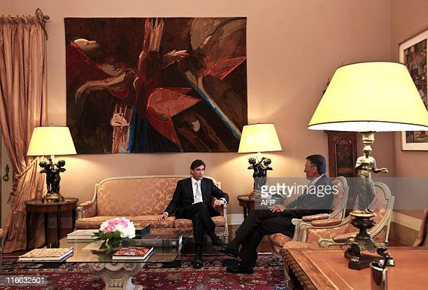 Party leader Pedro Passos Coelho talks with Portuguese President Anibal Cavaco Silva during a meeting at the Belem presidential palace in Lisbon, on...