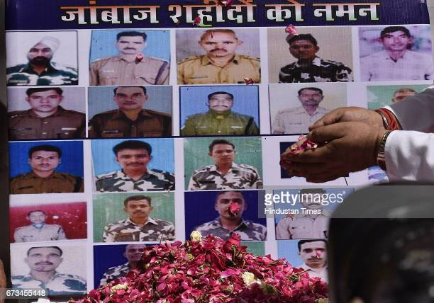 Party leaders pay tribute to CRPF jawans martyred in Sukma at Delhi Pant Marg BJP Office on April 26 2017 in New Delhi India It's a third term...