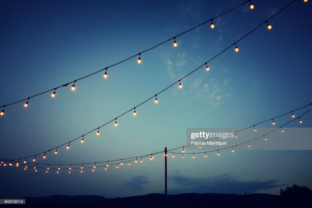 Party lights at outdoor wedding reception : Stock Photo