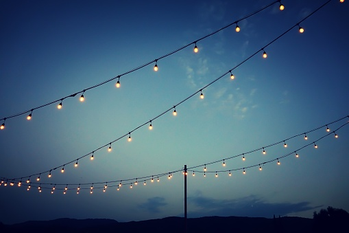 Party lights at outdoor wedding reception - gettyimageskorea