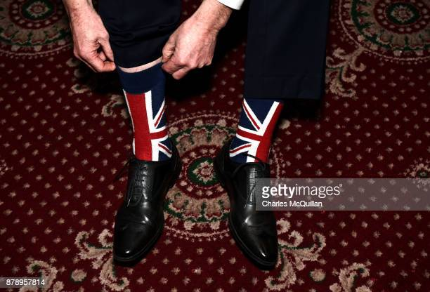 A party member sports a pair of Union Jack socks during Democratic Unionist Party deputy leader and Westminster leader Nigel Dodds' speech during the...