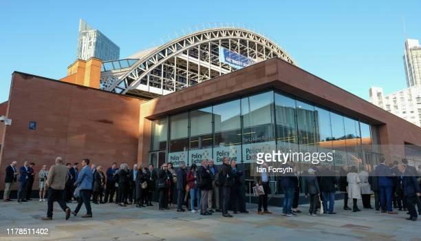 Party members and delegates queue ahead of the keynote speech by Prime Minister Boris Johnson on the final day of the Conservative Party Conference...