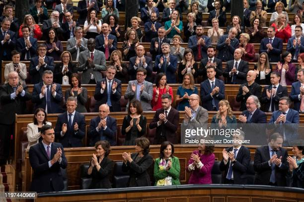 Party members applause at Spain's interim Prime Minister Pedro Sánchez after his speech during the investiture debate at the Spanish Parliament on...