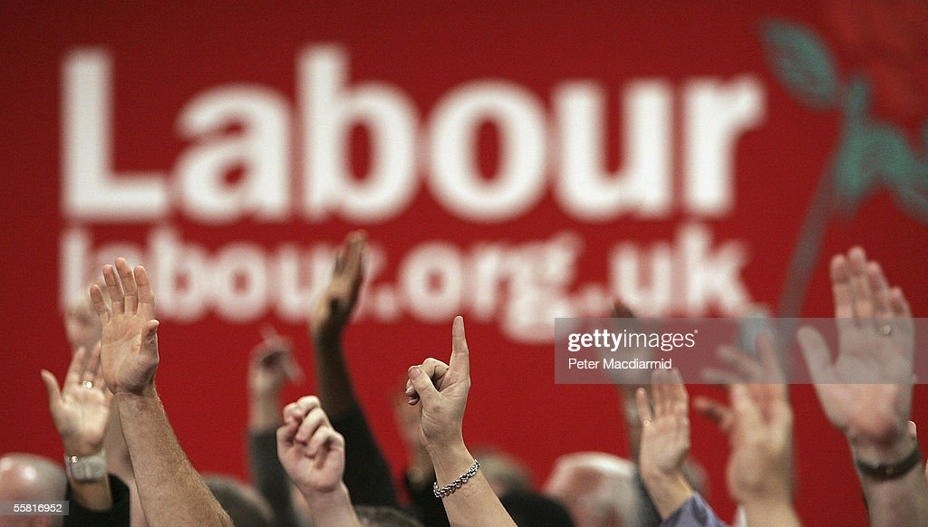 Party members raise their hand to vote during debates at the Labour Party conference on September 28, 2005 in Brighton, England. The governing Labour Party is holding its yearly conference at the English coastal resort until 29 September, 2005.