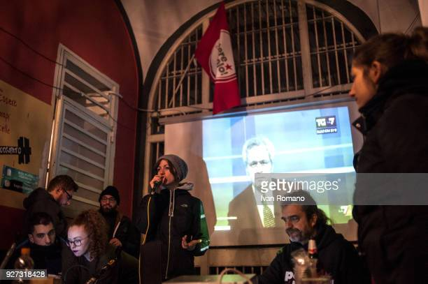Party militants Power to the world within the former EX OGP social center during the counting of the paper ballots on March 4 2018 in Naples Italy...