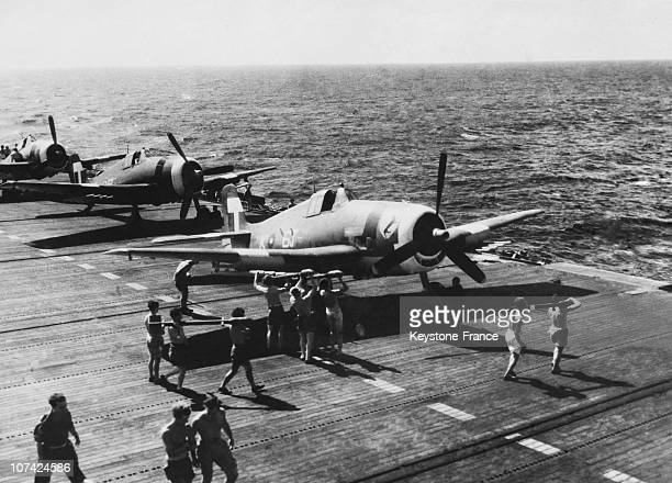 Party Of Armourers Loading A Hellcat Naval Fighter With Rocket Projectiles On June 25Th 1945