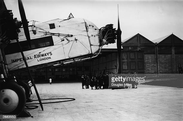 A party of bookmakers from Catford admires an Armstrong Whitworth Argosy airliner of Imperial Airways at Croydon Aerodrome in London 21st May 1931