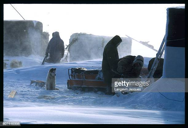 A party of Dolgan hunters work on a sled in their camp near the village of Syndassko Russia The Dolgans traditionally a nomadic people who live along...