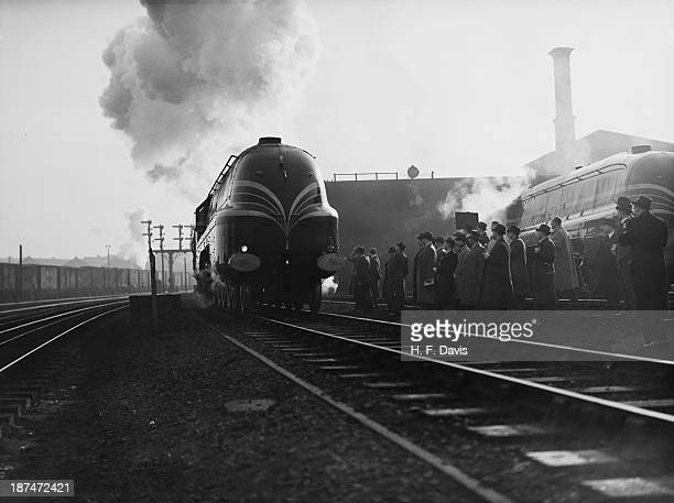 A party of German editors examining 6226 'Duchess of Norfolk' a streamlined Coronation Class locomotive of the London Midland and Scottish Railway...