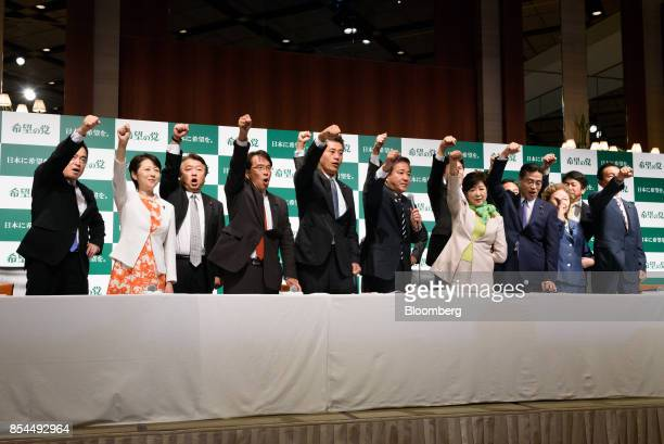 Party of Hope members pose for a photograph during a news conference in Tokyo Japan on Wednesday Sept 27 2017 A new political party set up by Tokyo...