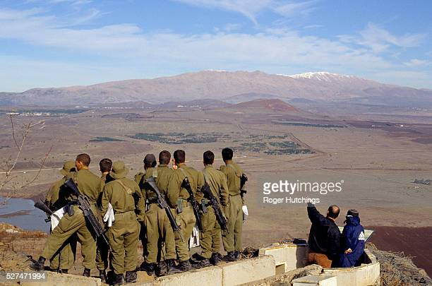 A party of Israeli soldiers visiting defensive emplacements on the Golan Heights looking towards the frontier with neighbouring Syria