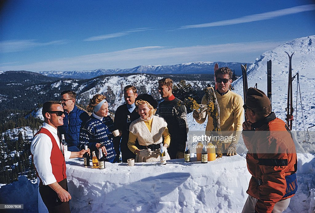 A party of skiers adjourn for drinks at the bar on top of peak KT-22, Squaw Valley, California, 1961. Second from right is American lawyer and businessman Alexander Cochrane Cushing (1913 - 2006), who developed the resort.