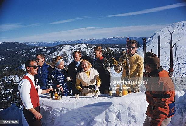 A party of skiers adjourn for drinks at the bar on top of peak KT22 Squaw Valley California 1961 Second from right is American lawyer and businessman...