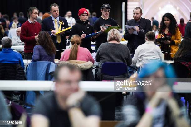 Party officials observe as counting staff count ballots at the main Glasgow counting centre in the SECC on December 12 2019 in Glasgow Scotland The...