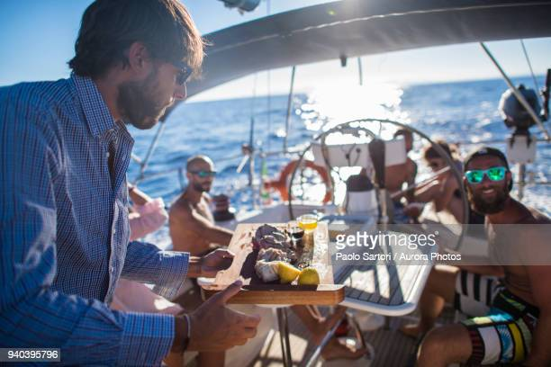 party on sailing boat, mallorca, spain - small group of people stock pictures, royalty-free photos & images