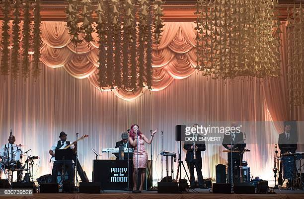 Party on the Moon performs during US Presidentelect Donald Trump's New Year's Eve party December 31 2016 at MaraLago in Palm Beach Florida / AFP /...