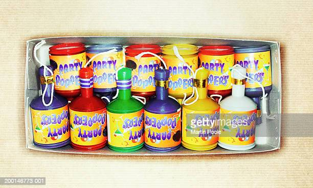 Party poppers in box, overhead view
