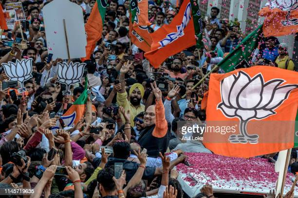 BJP party president Amit Shah waves at the BJP party workers at BJP party head party workers on May 23 2019 evening in New Delhi IndiaIndian Prime...