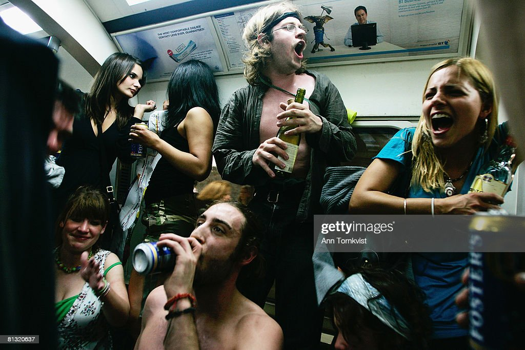 Party revellers enjoy the atmosphere on the London Underground during a Facebook cocktail party on the Circle Line on May 31, 2008 in central London, England. Tonight is the last evening when Londoners can consume alcohol on public transport. The cocktail party, organised on the networking Web site Facebook, attracted thousands of revellers to enjoy one last drink on the London Underground before the ban's enforcement on June 1, 2008. The ban, introduced by the new London Mayor Boris Johnson, is an attempt to clean up unruly behaviour on the London public transport system.