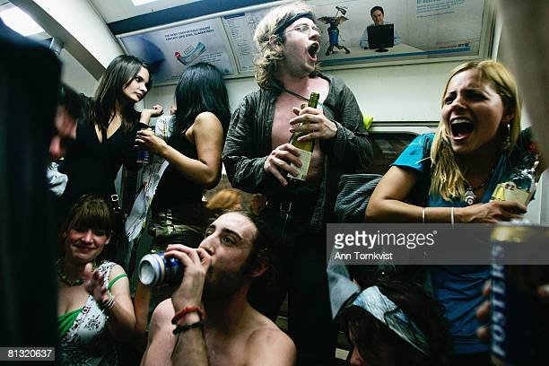 Party revellers enjoy the atmosphere on the London Underground during a Facebook cocktail party on the Circle Line on May 31 2008 in central London...