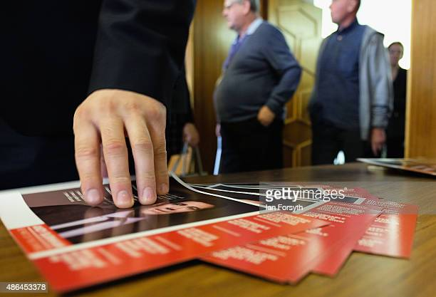 A party supporter picks up a campaign leaflet as Shadow Health Secretary and Labour leadership hopeful Andy Burnham speaks to party members during a...