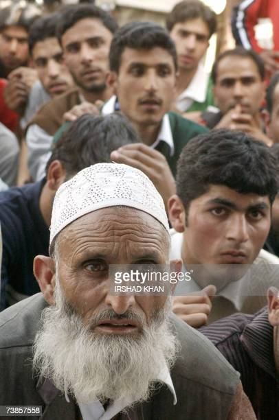 Party supporters listen to speeches during a welcoming ceremony for senior separatist leader and chairman of the Jammu and Kashmir National Front...