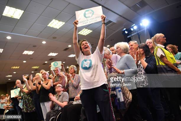 Party supporters react as Nigel Farage speaks during a Brexit Party rally at the John Smith's Stadium on May 13 2019 in Huddersfield England Nigel...