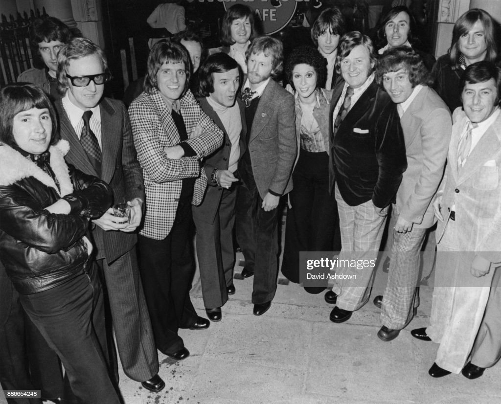 A party thrown by DJ Alan Freeman at the Hard Rock Cafe in London, to celebrate the arrival of his LP 'Alan Freeman's The History of Pop', 6th March 1974. From left to right, Reg Presley, Larry Page, Billy J. Kramer, Alan Freeman, Andrew Loog Oldham, Helen Shapiro, Don Lang, Tommy Bruce and Mitch Murray. At the back are Justin Hayward (far right) and Tony Hicks and Bobby Elliott of the Hollies.