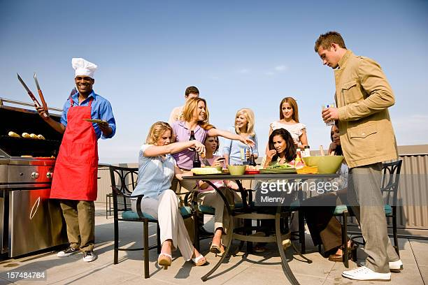 bbq party time - group of friends together having fun - penthouse girls stock pictures, royalty-free photos & images