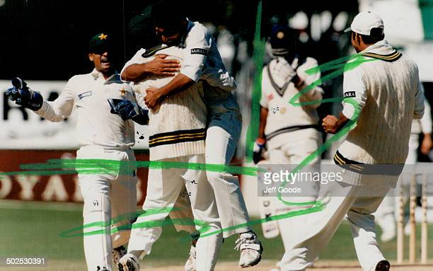 Party time Pakistan wicketkeeper Moin Khan left and bowler Azhar Mehmood right join teammate in celebration after taking Indian wicket yesterday