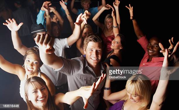 Party time - People dancing energetically in a nightclub