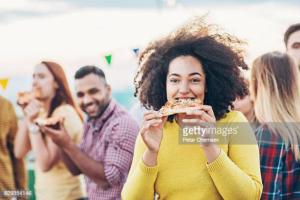 party with pizza - man eating woman out stock photos and pictures