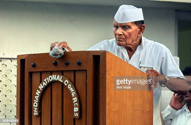 A party worker cleans the podium outside Sonia Gandhi's residence on May 17 2004 in New Delhi India India's president has asked primeministerelect...