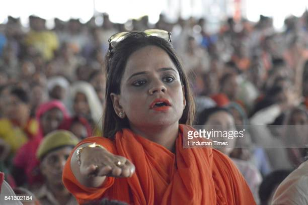 BJP party workers and supporters during the inauguration of the Kailash Mansarovar Bhawan by UP CM Yogi Adityanath at Kavi Nagar Ramlila Ground on...