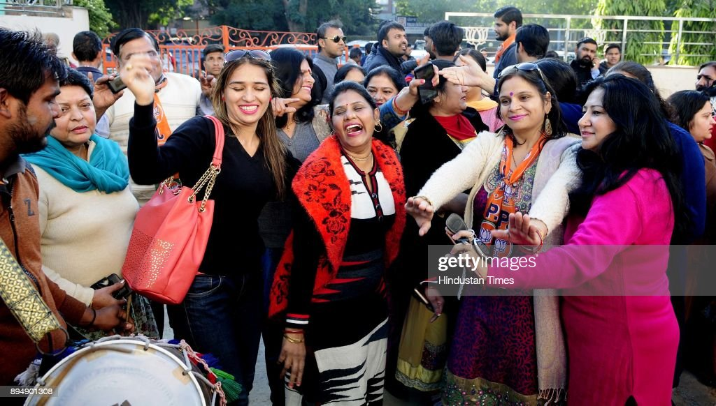 BJP party workers celebrate the victory of the party in Gujrat and Himachal Pradesh at Party office Kamalam Sector 33 on December 18 2017 in...