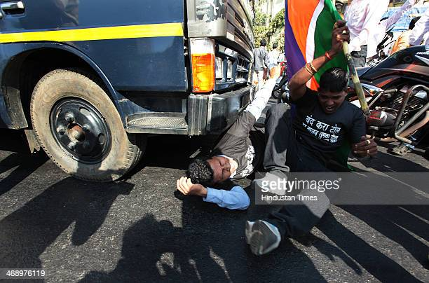 MNS party workers protested in front of vehicle in which Mumbai Police detained MNS Chief Raj Thackeray on Chunabhatti Bridge before Rasta Roko on...
