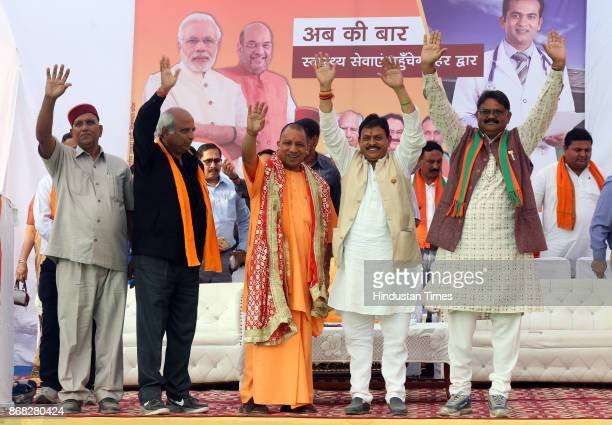 Party Workerss welcome Uttar Pradesh Chief Minister Yogi Adityanath during the election rally while campaigning for party candidate Arun Kumar from...