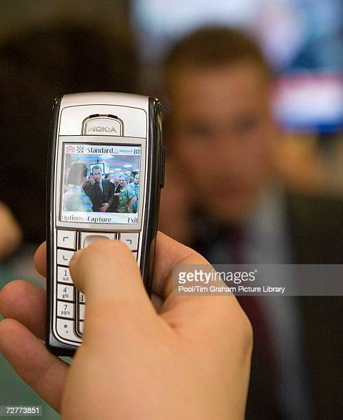 Partygoer takes a photograph of Prince William, Patron of the Tusk Trust, on a mobile phone during his visit to the City inter-dealer broker firm...