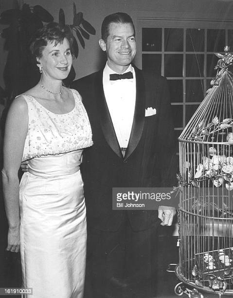 Partygoers at a recent gathering at the Denver Country Club, Mr. And Mrs. Barkley Clanahan, admire jewels in a gilded cage.;