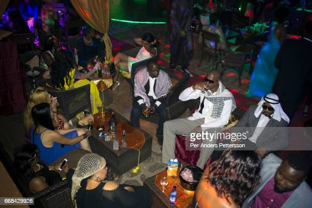 Partygoers attend an Arab Money themed party at a club in Kampala Uganda on December 18 2014 Wealthy people from Uganda and neighboring countries...
